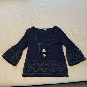 Light weight embroidered shirt with tassels.